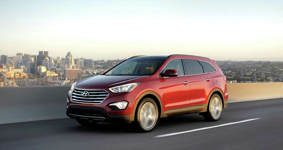 Powered by a 290-horsepower, 3.3-liter V6, Hyundai's Santa Fe three-row crossover utility vehicle offers up to 80 cubic feet of cargo space with the second- and third-row seats folded down. Photo: Hyundai