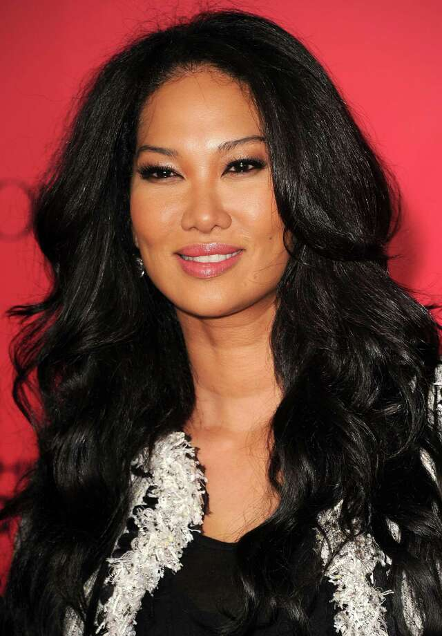 Kimora Lee Simmons, shown here at a 2013 film premier, is set to hand out aid Sunday to those devastated by Hurricane Harvey. Photo: Steve Granitz, Getty Images / 2013 Steve Granitz
