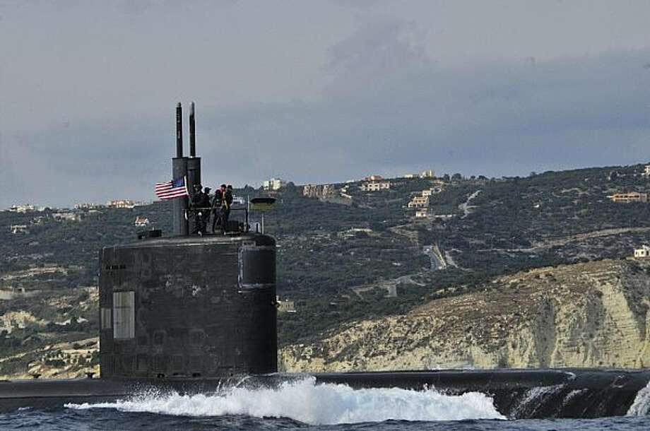 "The Los Angeles-class fast attack submarine USS Alexandria (SSN 757) departs Souda Bay, Greece. Alexandria is homeported in Groton, Conn. Kristian Saucier, who served as a petty officer on the sub was indicted by a federal grand jury in Bridgeport, Conn. on Thursday, July 24, 2015 charging him, with unlawfully retaining photos taken inside restricted areas of a nuclear attack submarine and obstructing the investigation. Photo: D. L. ""Paul"" Farley / U.S. Navy / Navy Media Content Services"