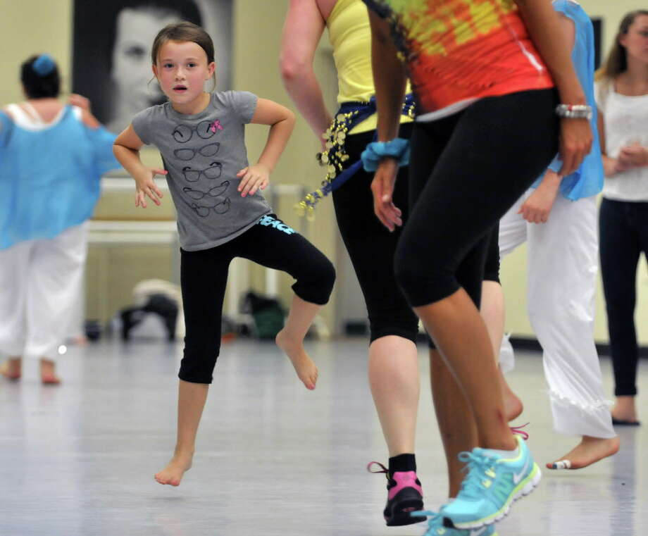 Grace Haas, 8, of Malta takes part in a Zumba dance at the National Museum of Dance during the Annual National Dance Day Celebration on Sunday, July 28, 2013 in Saratoga Springs, NY.  (Paul Buckowski / Times Union archive) Photo: Paul Buckowski / 00023275A