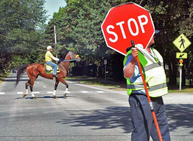 Horse crossing on Union Avenue as Saratoga Race Course opens for the season Friday July 24, 2015 in Saratoga Springs, NY.  (John Carl D'Annibale / Times Union) Photo: John Carl D'Annibale, Albany Times Union / 00032586B