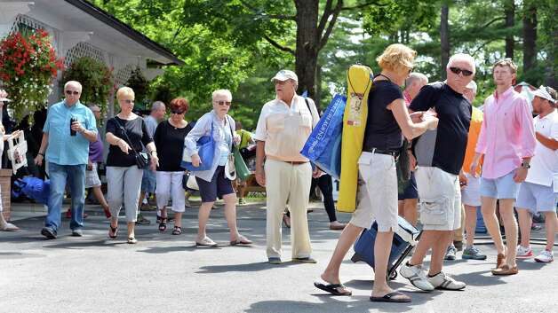 Race fans file into Saratoga Race Course as it opens for the season Friday July 24, 2015 in Saratoga Springs, NY.  (John Carl D'Annibale / Times Union) Photo: John Carl D'Annibale, Albany Times Union / 00032586B