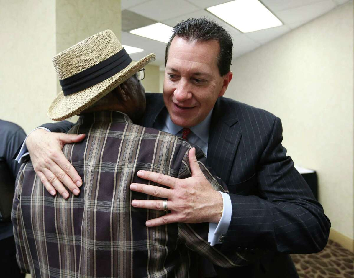 Attorney Andy Taylor hugs F. N. Williams Sr., the lead plaintiff in the case, following a press conference celebrating the Texas Supreme Court's suspension of the HERO ordinance Friday, July 24, 2015, in Houston. The decision will force city council to consider a repeal, or place the issue on the ballot in November.