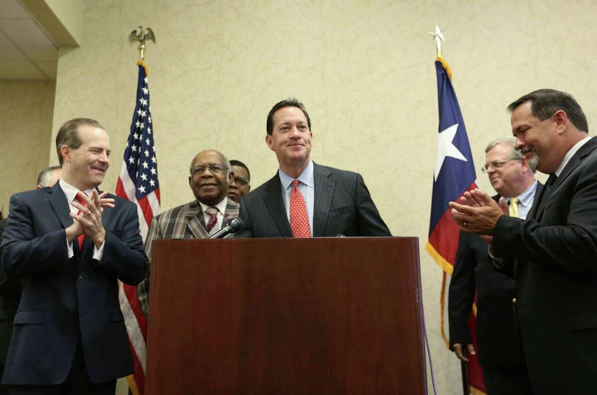 Attorney Andy Taylor takes the podium to applause from supporters during a press conference celebrating the Texas Supreme Court's suspension of the HERO ordinance Friday, July 24, 2015, in Houston. The decision will force city council to consider a repeal, or place the issue on the ballot in November.
