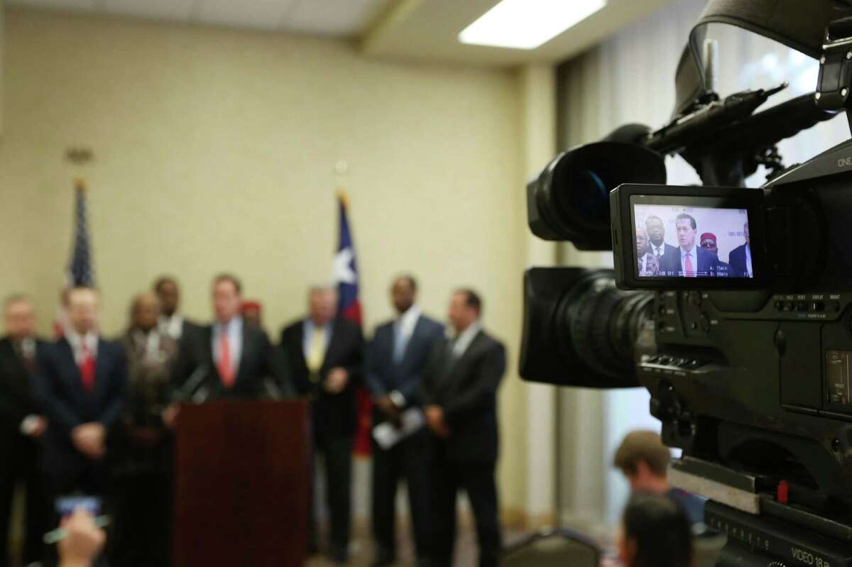 Members of the media record Andy Taylor speaking about the Texas Supreme Court's suspension of the HERO ordinance during a press conference Friday, July 24, 2015, in Houston. The decision will force city council to consider a repeal, or place the issue on the ballot in November.