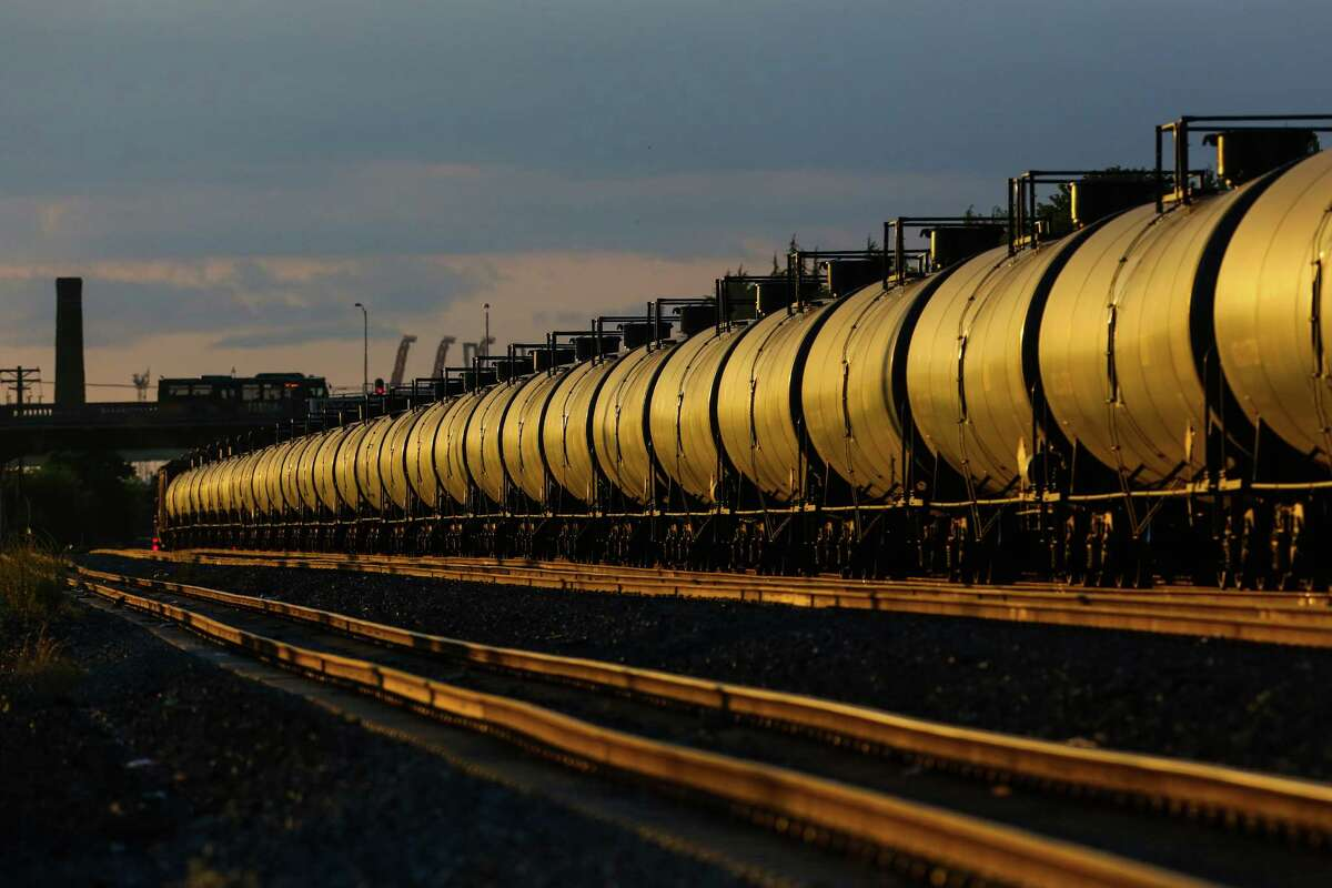 An oil train is shown passing through Seattle. The highly controversial trains haul rail cars loaded with oil brought from the oil fields of North Dakota and Montana.