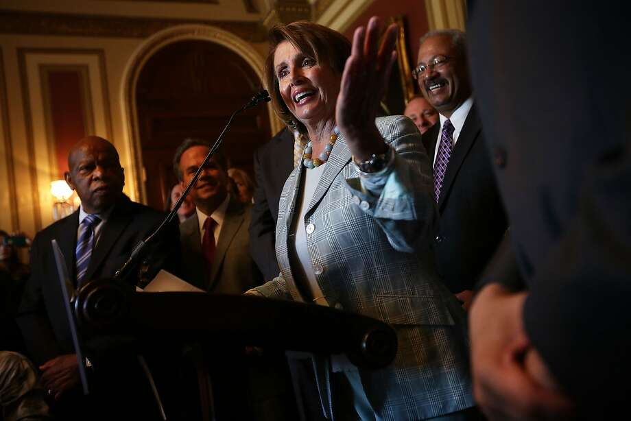 Rep. John Lewis, D-Ga. (left) listens as Rep. Nancy Pelosi speaks during a news conference on the Equality Act. Photo: Alex Wong, Getty Images