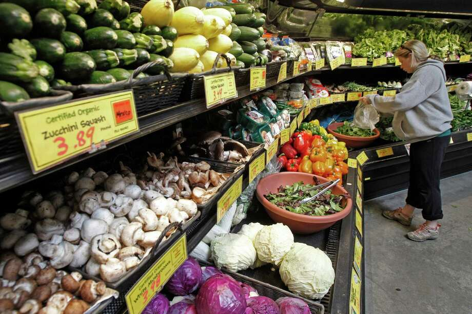 A customer shops for produce at a co-op in Montpelier, Vt., a state that last year passed legislation requiring mandatory labeling of food last year passed legislation requiring mandatory labeling of food from GMOsfrom GMOs Vermont's 17 food cooperatives are supporting a bill that would require the labeling of genetically modified foods. The co-ops said Tuesday that their member owners want to know which foods in their stores contain genetically modified organisms. (AP Photo/Toby Talbot) Photo: Associated Press File Photo / AP