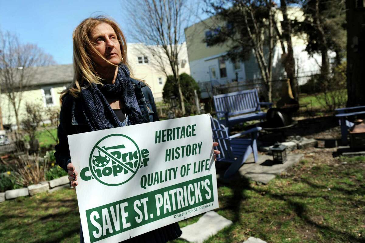 Christine Bulmer holds an anti-demolition sign as she shows her history of support for St. Patrick's Roman Catholic Church on Wednesday, April 17, 2013, at her home in Watervliet, N.Y. (Cindy Schultz / Times Union)