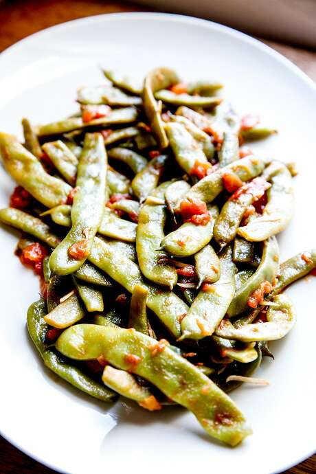 Romano beans smothered in garlicky tomatoes. Photo: Sarah Rice, Special To The Chronicle