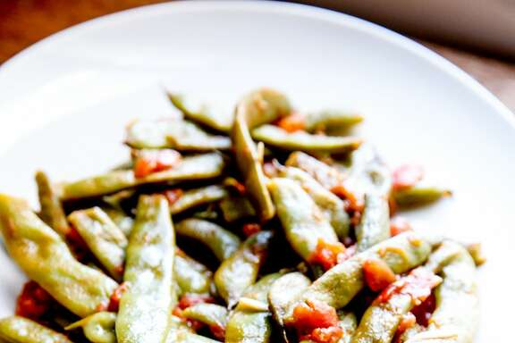 Romano beans smothered in garlicky tomatoes at the home of Molly Watson in San Francisco, Calif., Friday, July 24, 2015.