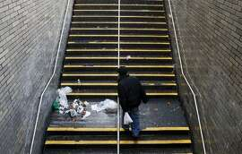 Trash litters the staircase to Muni Metro.