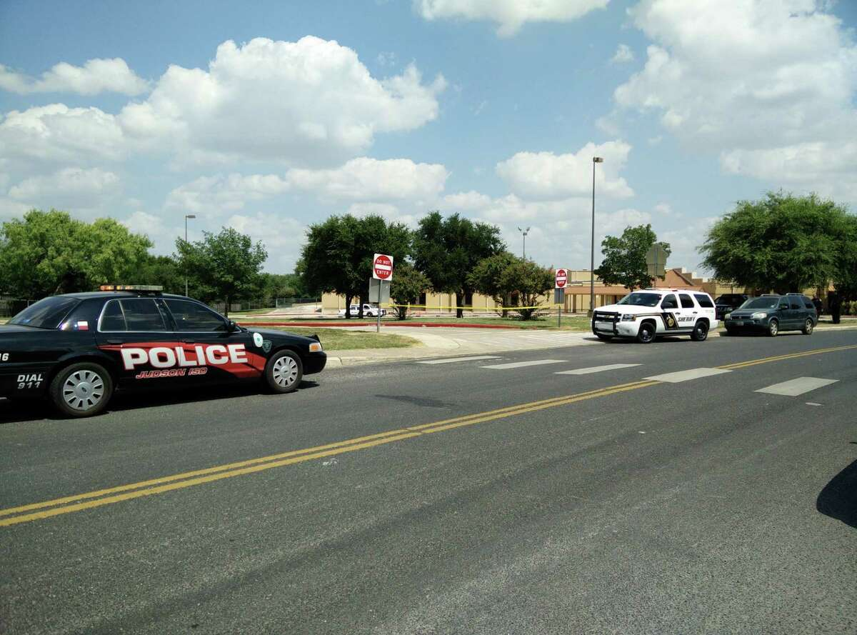 Police secure the scene at Elolf Elementary School in Converse after a shooting on July 24, 2015.