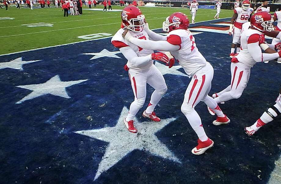 Houston Cougars players warm up before the start of action against Pittsburgh in the Armed Forces Bowl at Amon G. Carter Stadium in Fort Worth, Texas, on Friday, Jan. 2, 2015. Houston rallied to win, 35-34. (Ron Jenkins/Fort Worth Star-Telegram/TNS) Photo: Ron Jenkins, MBR / McClatchy-Tribune News Service / Fort Worth Star-Telegram