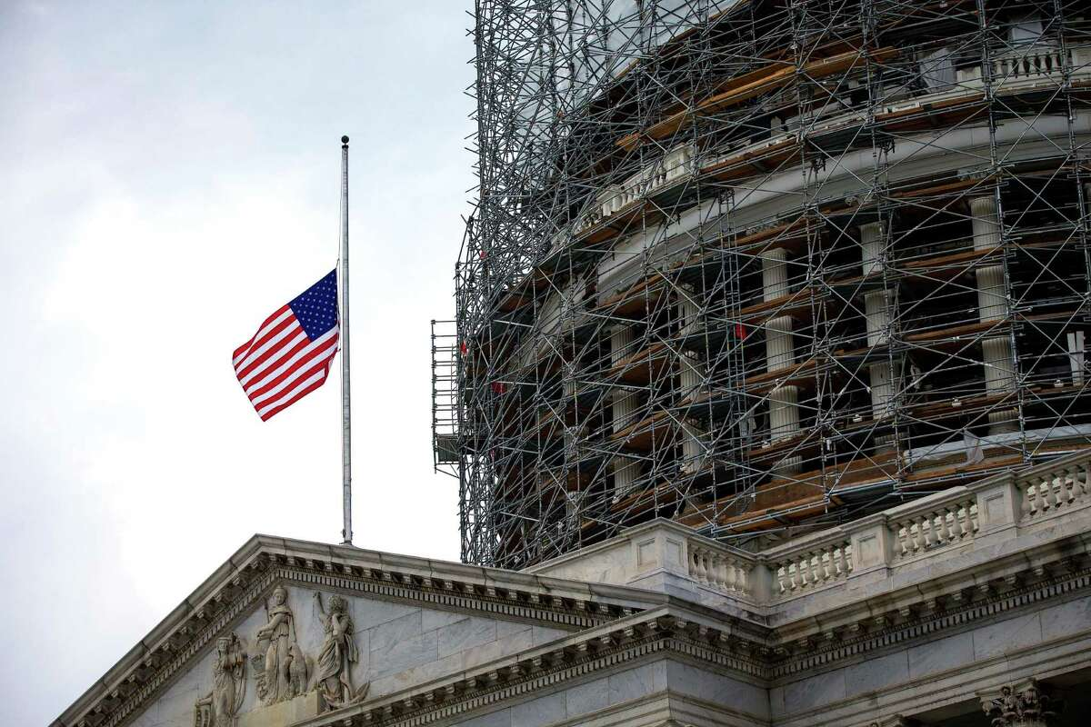 A flag flies at half-staff on Capitol Hill in Washington. President Obama on Tuesday ordered the flag at the White House and other public buildings to be lowered to half-staff in honor of the five military service members killed by a gunman in Chattanooga, Tenn. A reader criticizes the president for waiting until he was criticized by Republicans.