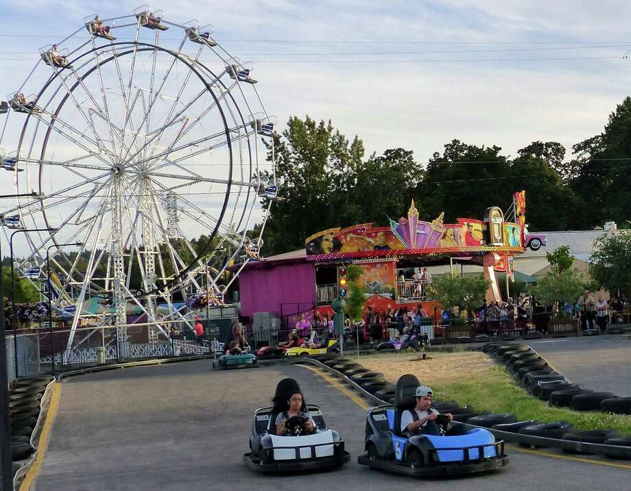 Go-carts and an old-fashioned Ferris wheel are among draws to Oaks Park amusement park in Portland, Ore. Photo: Brian J. Cantwell /McClatchy-Tribune News Service / Seattle Times