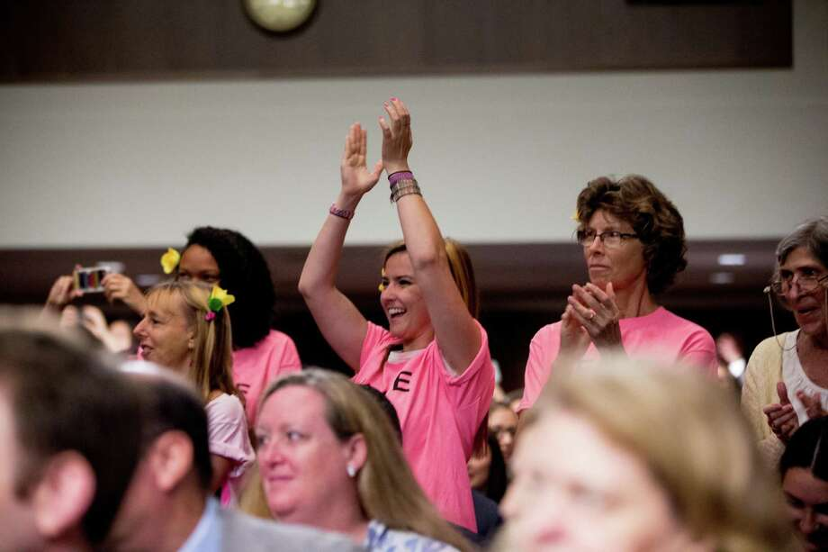 Members of the anti-war group Code Pink applaud as Secretary of State John Kerry arrives to testify about the nuclear deal with Iran at a Senate Foreign Relations Committee hearing on Capitol Hill,. Some of our readers are not as happy with the deal. Photo: Andrew Harnik /Associated Press / AP