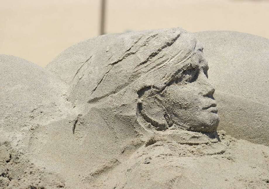 The head of a sand sculpture by Edith Van De Wetering of Holland emerges during the Greenwich Arts Council's Sandblast! sand sculpture festival, at Greenwich Point Saturday, July 9, 2011. Photo: Bob Luckey / ST / Greenwich Time