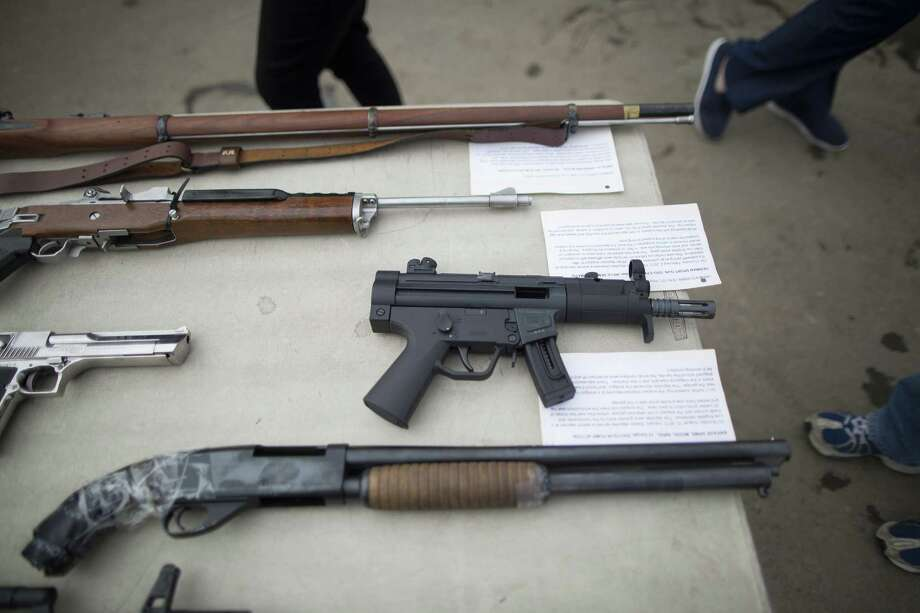 This file photo shows guns confiscated guns by Los Angeles area law enforcement agencies. The U.S. must enact gun control measures to stop violent extremists from carrying out their fantasies. Photo: David McNew /Getty Images / 2015 David McNew