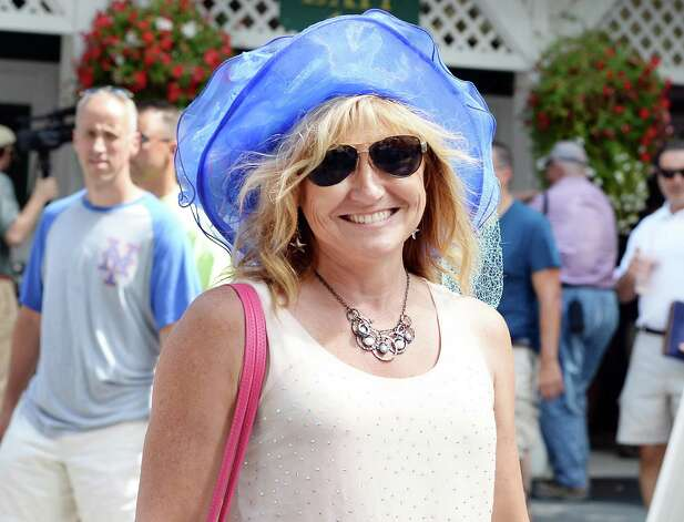 Donna Zawerton of Newington, Conn., arrives at Saratoga Race Course for opening day of the season Friday July 24, 2015 in Saratoga Springs, NY.  (John Carl D'Annibale / Times Union) Photo: John Carl D'Annibale / 00032586B