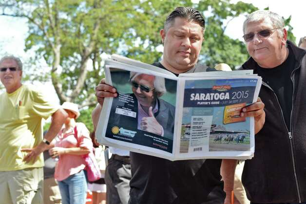 Joe Pizzuto and Tom Abate, right, of Lawrence, Mass., pick their winners as they wait for the gates to open as Saratoga Race Course opens for the season Friday July 24, 2015 in Saratoga Springs, NY.  (John Carl D'Annibale / Times Union) Photo: John Carl D'Annibale / 00032586B