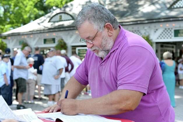 Randy Sheehan of Albany plans out his bets as he waits for the gates to open as Saratoga Race Course opens for the season Friday July 24, 2015 in Saratoga Springs, NY.  (John Carl D'Annibale / Times Union) Photo: John Carl D'Annibale / 00032586B