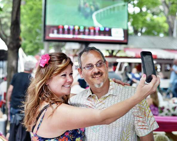 Tracell, left, and David Gapczynski of Glenville take a selfie in the picnic area at Saratoga Race Course Friday July 24, 2015 in Saratoga Springs, NY.  (John Carl D'Annibale / Times Union) Photo: John Carl D'Annibale / 00032586B