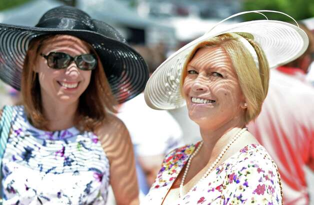Laura Hathaway, left, and Lisa Williams of Orlando, Fla., sport fashionable hats on opening day at Saratoga Race Course Friday July 24, 2015 in Saratoga Springs, NY.  (John Carl D'Annibale / Times Union) Photo: John Carl D'Annibale / 00032586B