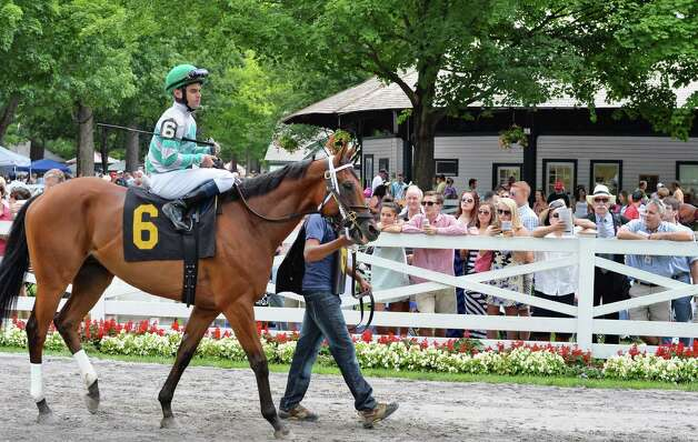 Jockey Fernando Jara aboard Native Hero leaves the paddock for the first race at Saratoga Race Course Friday July 24, 2015 in Saratoga Springs, NY.  (John Carl D'Annibale / Times Union) Photo: John Carl D'Annibale / 00032586B