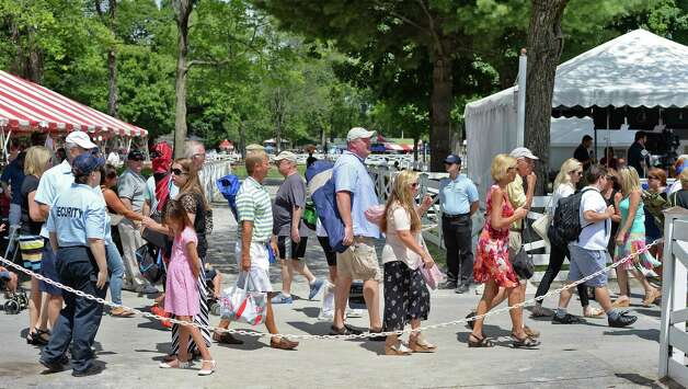 Race fans file in on opening day at Saratoga Race Course Friday July 24, 2015 in Saratoga Springs, NY.  (John Carl D'Annibale / Times Union) Photo: John  Carl D'Annibale / 00032586B