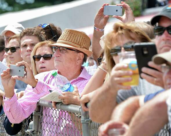 Rail birds use their smart phones to picture the finish of the second race at Saratoga Race Course Friday July 24, 2015 in Saratoga Springs, NY.  (John Carl D'Annibale / Times Union) Photo: John Carl D'Annibale / 00032586B
