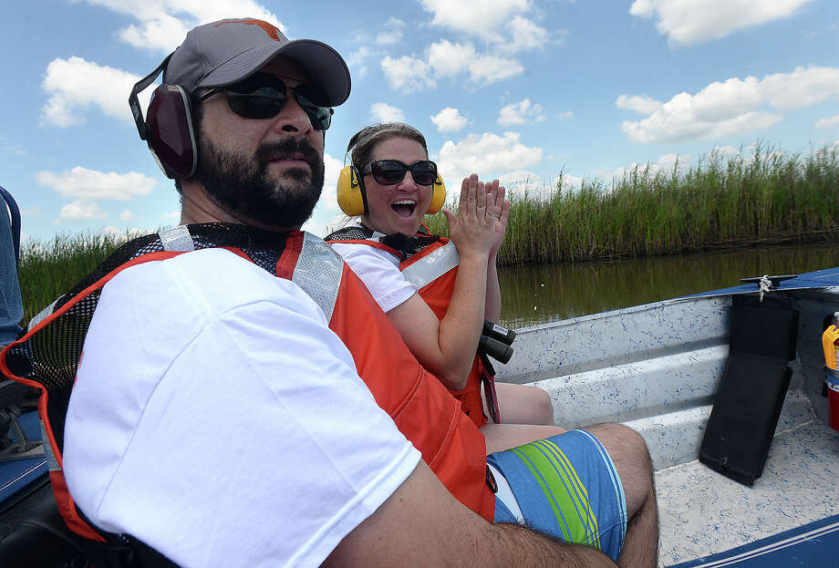 Drema Quinn, a science teacher with Pasadena ISD, and husband Chris Quinn, enjoy a tour of the Bessie Heights Marsh after boarding an airboat at the Port Neches Park boat ramp Friday. The tour of the area, which was the scene of the Chevron oil spill in 1993 and has been part of a restoration project by the Texas General Land Office Oil Spill Division, capped the two-week environmental workshop hosted by Lamar University's Department of Earth and Space Sciences. Graduate students and science teachers from throughout the state participated in the program, which is in its 20th year. In addition to the boat tour, participants toured several of the refineries in the region.  Photo taken Friday, July 24, 2015 Kim Brent/The Enterprise Photo: Kim Brent / Beaumont Enterprise