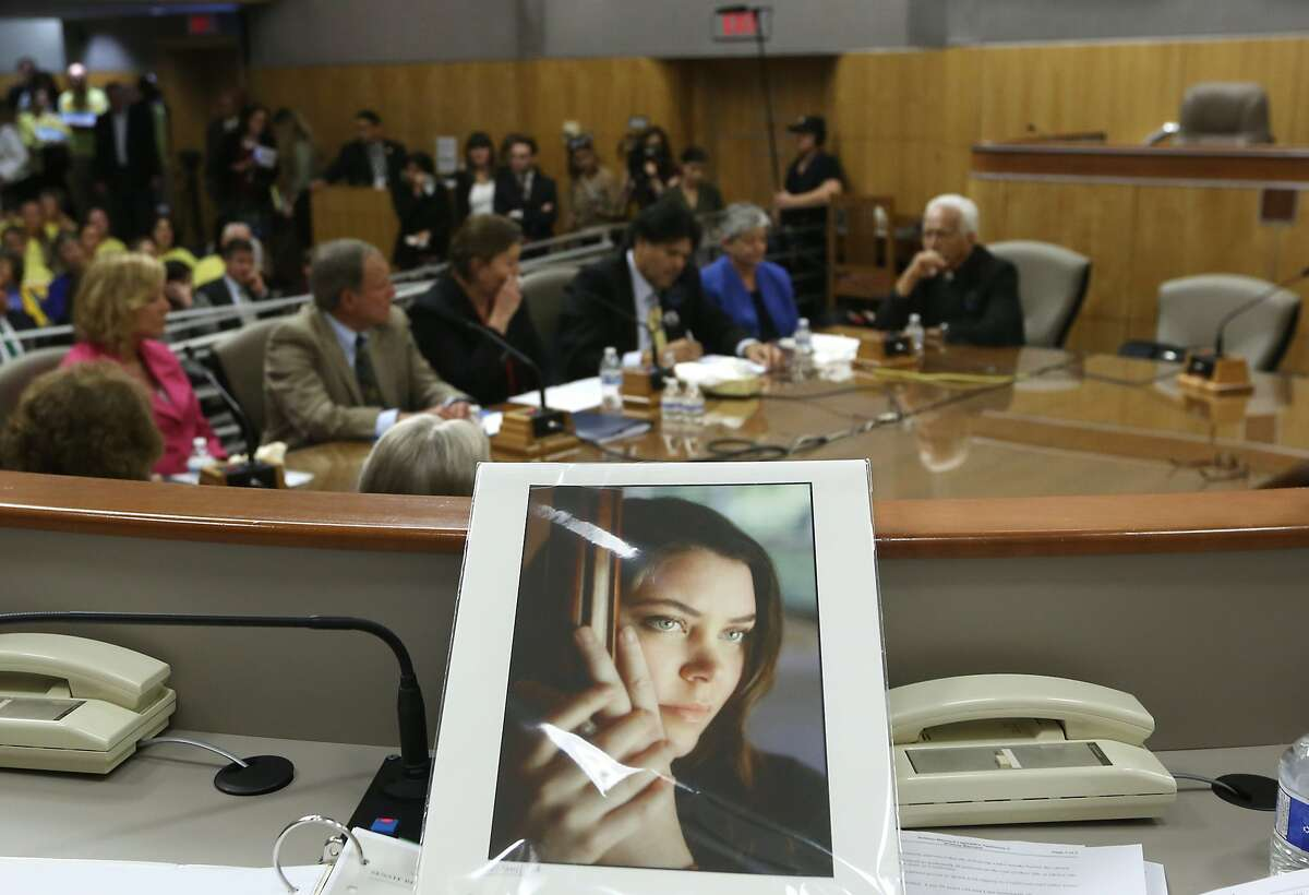 A portrait of Brittany Maynard sits on the dias of the Senate Health Committee at the California Capitol. Maynard, who was dying of brain cancer, used her final days to advocate for California to adopt an aid-in-dying law so others would not have to move out of the state for similar relief.