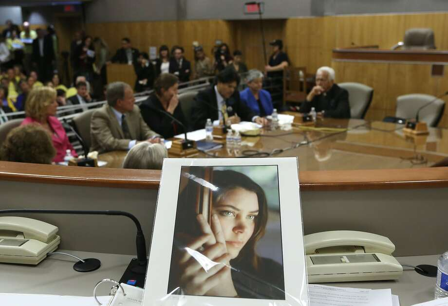 A photo of Brittany Maynard, who moved to Oregon to control her death, is featured at a California Senate panel's hearing on an aid-in-dying bill in March. Photo: Rich Pedroncelli, Associated Press