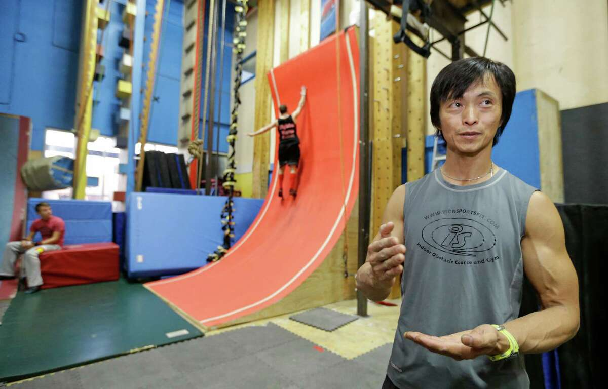 Sam Sann, owner of Iron Sports Fit, 6982 FM 1960 W, is shown during his Ninja Training class Tuesday, July 14, 2015, in Houston.