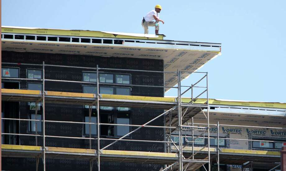 A construction worker overlooks The Susanne, a luxury apartment complex, construction site on Wednesday, Aug. 13, 2014, in Houston.  ( Mayra Beltran / Houston Chronicle ) Photo: Mayra Beltran, Staff / © 2014 Houston Chronicle