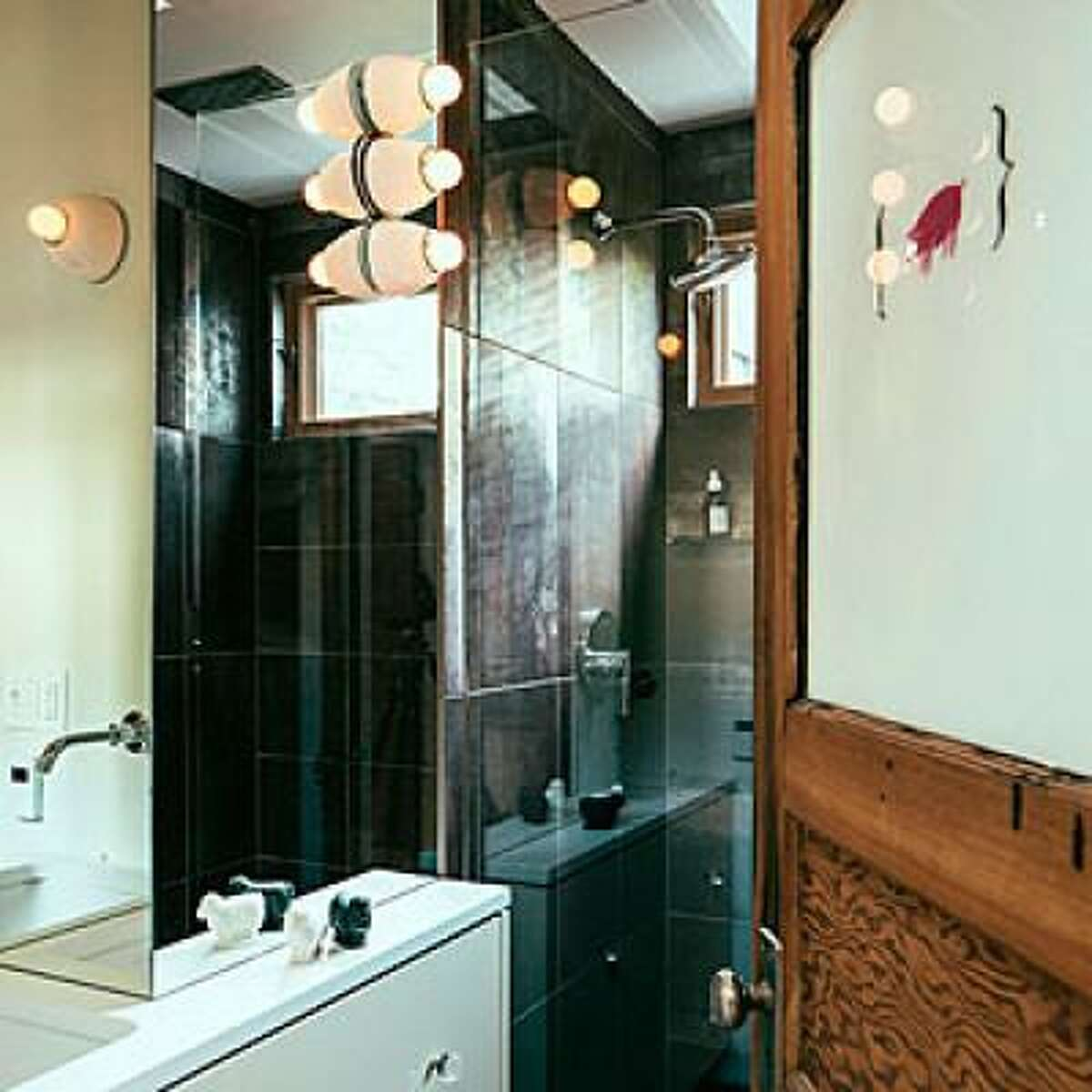 Reflect everything Homeowner Daniel Thomas ditched the painted walls in his Portland Victorian for walls covered in mirrors. Even though the bathroom is barely big enough for the door to swing open, the mirrors trick you into thinking it's twice the size. Also helping: the glass door to the shower and glass ceiling that reveals rafters above. See the rest of this modernized Victorian home Read more: 14 new ways to revamp your bathroom