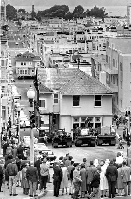 A house once owned by Dr. Herbert Moffitt is moved in sections through San Francisco streets on its way to a trip by barge to a new location in Belvedere. Photo: Bob Campbell / Bob Campbell / The Chronicle 1962 / ONLINE_YES