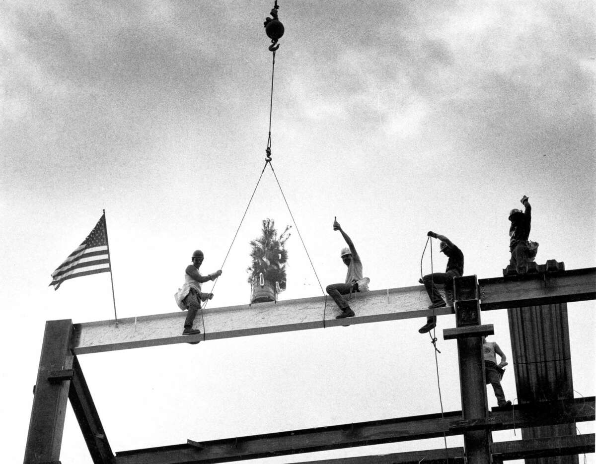 Oct. 22, 1982: Construction workers celebrate with champagne after setting the last steel beam on the San Francisco ballet building.