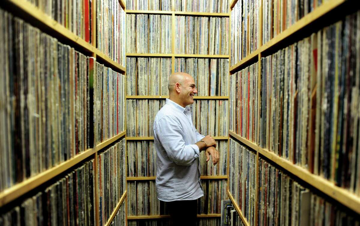 Steven di Costanzo, general manager at WPKN 89.5, walks past the station's vast collection of LPs Friday, July 17, 2015, at their studio on the campus of the University of Bridgeport.