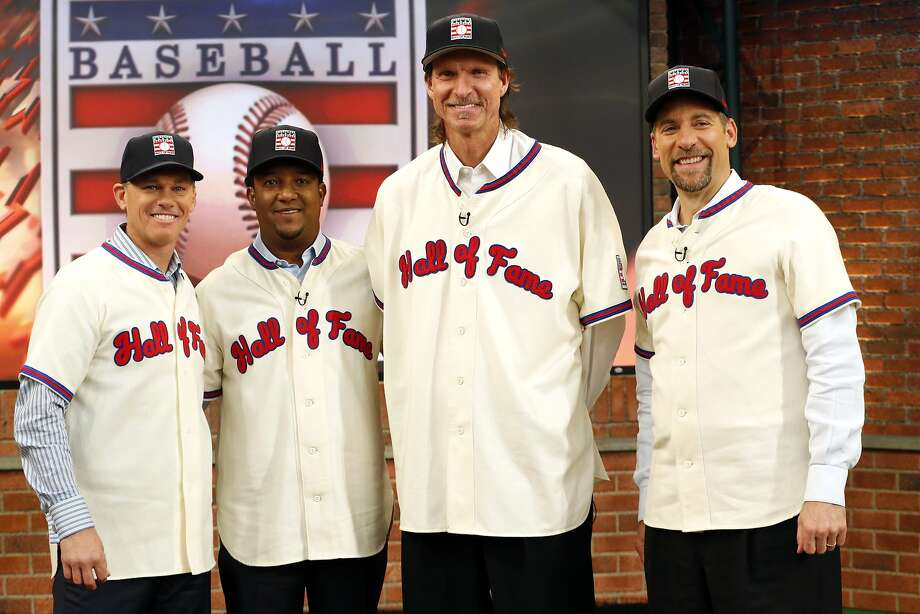 ADVANCE FOR WEEKEND EDITIONS, JUNE 24-26 - FILE - In this Jan. 7, 2015, file photo, members of the National Baseball Hall of Fame 2015 inductee class, from left, Craig Biggio, Pedro Martinez, Randy Johnson and John Smoltz pose for photographers at the MLB Network's Studio 42 in Secaucus, N.J. All four will be inducted Sunday, July 26, 2015, in Cooperstown. (AP Photo/Julio Cortez, File) Photo: Julio Cortez, Associated Press