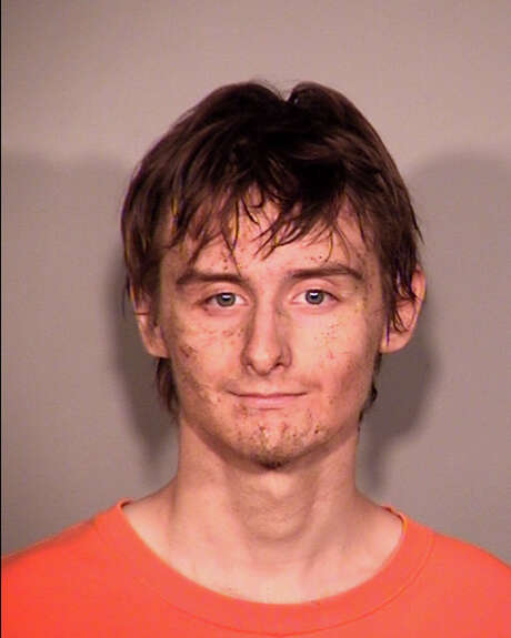 This photo provided by the Broken Arrow, Okla., Police Department shows Robert Bever, a suspect in the stabbing deaths of an Oklahoma family in Broken Arrow, Thursday, July 23, 2015. Broken Arrow Police spokesman Cpl. Leon Calhoun said Thursday that Bever and another teenage son were apprehended and expected to be charged in the deaths of their parents, three siblings and an attack on a fourth sibling. (Broken Arrow Police Department via AP) Photo: Associated Press / Broken Arrow Police Department