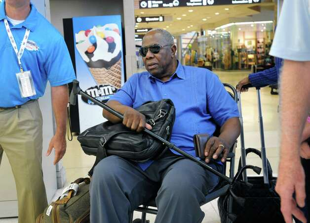 Baseball great Hank Aaron looks for his luggage on the carousel at the Albany International Airport on his way to Cooperstown for the Hall of Fame weekend on Thursday, July 24, 2015 in Albany, N.Y. (Lori Van Buren / Times Union) Photo: Lori Van Buren / 00032750A