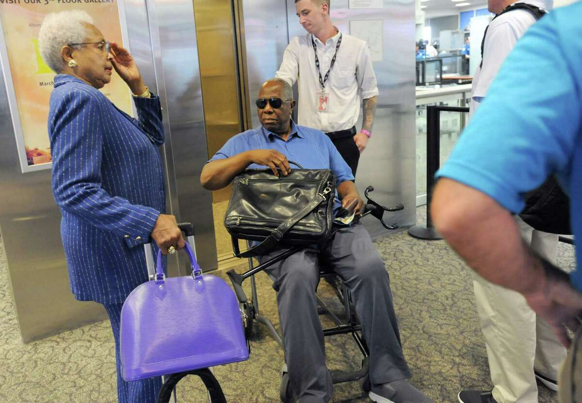 Baseball great Hank Aaron arrives at the Albany International Airport on his way to Cooperstown for the Hall of Fame weekend on Thursday, July 24, 2015, in Albany, N.Y. His wife Billye, left, gets ready to get on the elevator with him. (Lori Van Buren / Times Union)