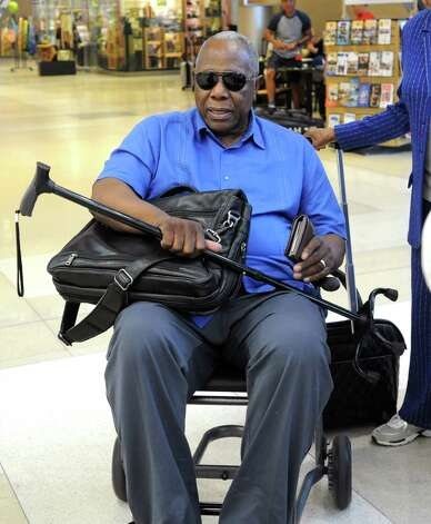 Baseball great Hank Aaron arrives at the Albany International Airport on his way to Cooperstown for the Hall of Fame weekend on Thursday, July 24, 2015 in Albany, N.Y. (Lori Van Buren / Times Union) Photo: Lori Van Buren / 00032750A