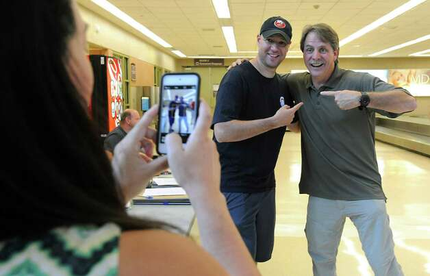Claudia Kay of Long Island takes a photo of her husband Glenn Kay with comedian and television personality Jeff Foxworthy at the Albany International Airport on Thursday, July 24, 2015 in Albany, N.Y. Jeff was on his way to Cooperstown for Hall of Fame weekend to see his friend John Smoltz be inducted this year. (Lori Van Buren / Times Union) Photo: Lori Van Buren / 00032750A