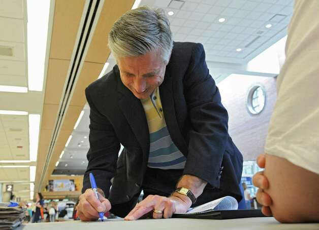 Detroit Tigers General Manager Dave Dombrowski signs an autograph for a fan at the Albany International Airport on his way to Cooperstown for Hall of Fame weekend on Thursday, July 24, 2015 in Albany, N.Y.  (Lori Van Buren / Times Union) Photo: Lori Van Buren / 00032750A
