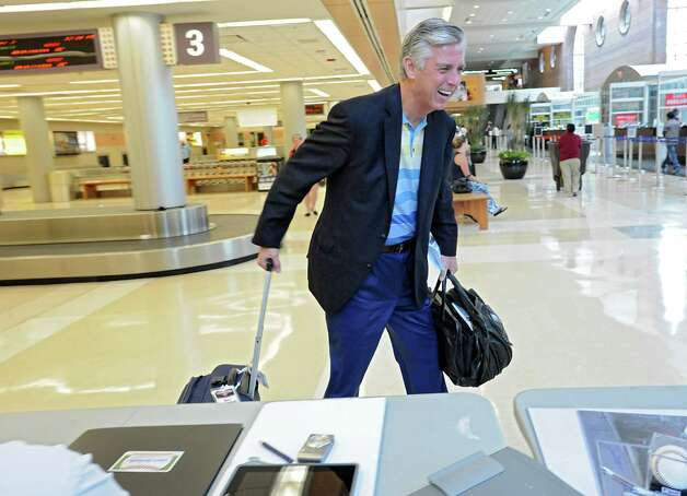 Detroit Tigers General Manager Dave Dombrowski leaves the Albany International Airport on his way to Cooperstown for Hall of Fame weekend on Thursday, July 24, 2015 in Albany, N.Y.  (Lori Van Buren / Times Union) Photo: Lori Van Buren / 00032750A