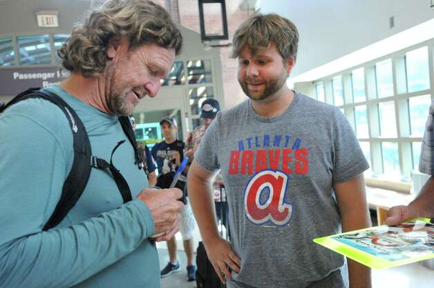 Hall of famer Robin Yount, left, signs an autograph for Nate Rupp of Atlanta, GA after arriving at the Albany International Airport on his way to Cooperstown for Hall of Fame weekend on Thursday, July 24, 2015 in Albany, N.Y. Yount spent his entire 20-year career in Major League Baseball as a shortstop and center fielder for the Milwaukee Brewers. Nate will be heading to Cooperstown for the induction ceremony.  (Lori Van Buren / Times Union) Photo: Lori Van Buren / 00032750A
