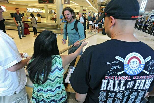 Hall of famer Robin Yount, center, signs autographs for memorabilia collectors after arriving at the Albany International Airport on his way to Cooperstown for Hall of Fame weekend on Thursday, July 24, 2015 in Albany, N.Y. Yount spent his entire 20-year career in Major League Baseball as a shortstop and center fielder for the Milwaukee Brewers.  (Lori Van Buren / Times Union) Photo: Lori Van Buren / 00032750A